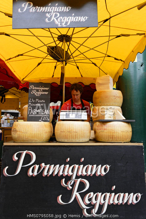 United Kingdom, London, seller of Parmesan cheese in Borough Market