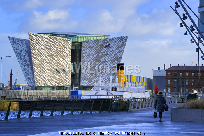 United Kingdom, Northern Ireland, Belfast, the new Titanic Quarter of Queen's Island, the SS Nomadic of the White Star Line built as a tender to the liners RMS Olympic and RMS Titanic, and the Titanic Belfast Experience center in the background