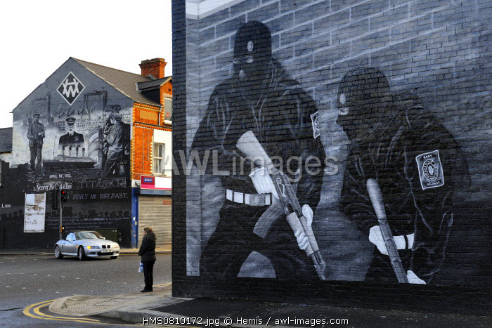 United Kingdom, Northern Ireland, East Belfast, protestant loyalist districts of Newtownards road, political wall paintings to the glory of Loyalist militias and mural in memory of the Titanic built in Belfast in the background