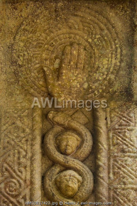 Ireland, County Louth, Monasterboice, Muiredach's High cross (900-923 AD), Interlaced portrait heads and snakes surmounted by the hand of God The 5,5-metre Muiredach's High Cross is regarded as the finest high cross in the whole of Ireland, It is named after an abbot, Muiredach mac Domhnaill, who died in 923 and features biblical carvings of both the Old and New Testaments of the Bible,