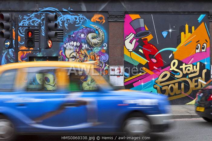United Kingdom, London, East End District, Old Street, taxi blur and painted wall