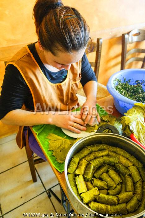 Woman preparing fresh Dolmades - Stuffed Vine Leaves. Chania Old Town, Crete, Crete
