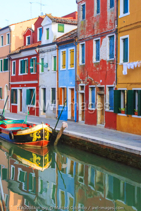 Italy, Venice, Burano. View of a canal with typical colorful houses