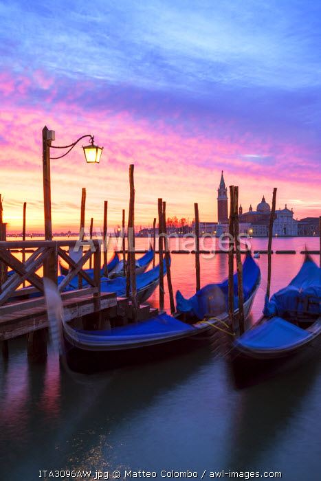 Italy, Venice. Gondolas moored on Riva degli Schiavoni at sunrise