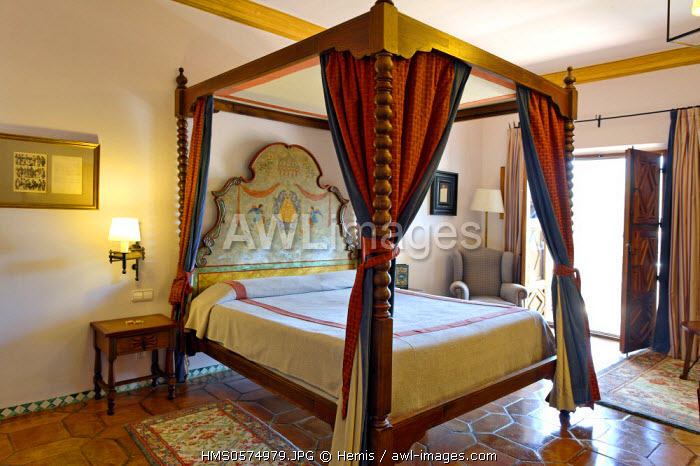 Spain, Extremadura, Guadalupe, Parador of Tourism, canopy bed in a bedroom