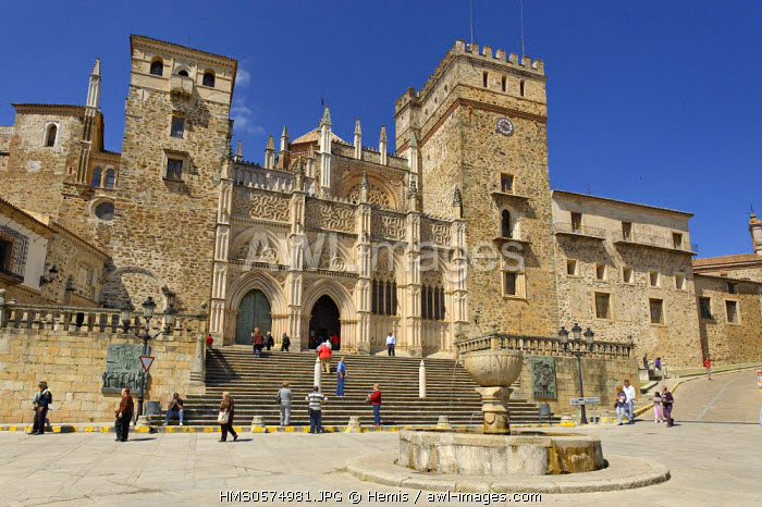 Spain, Extremadura, Guadalupe Royal Monastery of Santa Maria de Guadalupe listed as World Heritage by UNESCO, facade of the sanctuary in front of the fountain in the Main Square