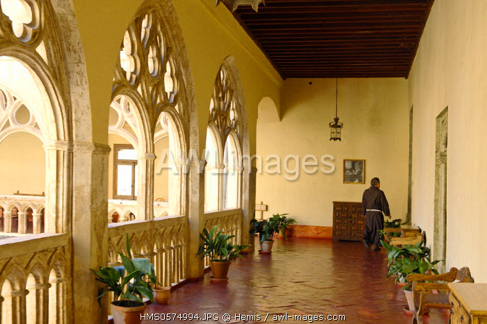 Spain, Extremadura, Guadalupe, Royal Monastery of Santa Maria de Guadalupe listed as World Heritage by UNESCO, Gothic cloister surrounded by three rows of arches seen in the corridors