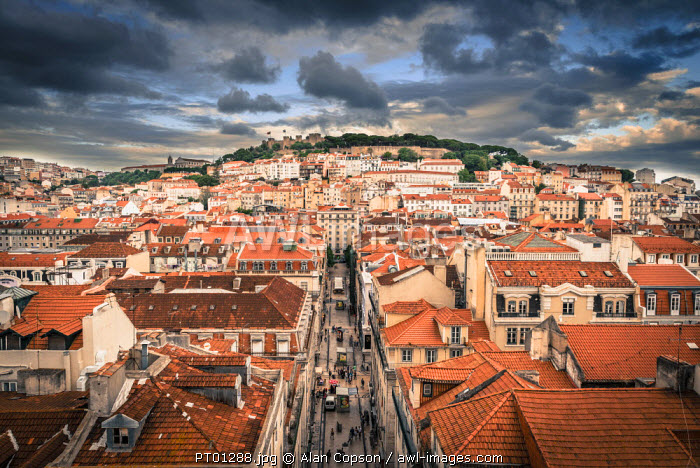 Portugal, Lisbon, rooftop view of Baixa District with Sao Jorge Castle and Alfama District beyond