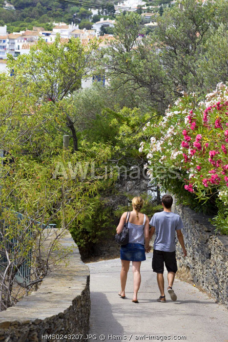 Spain, Catalonia, Costa Brava, Cadaques, couple walking along path