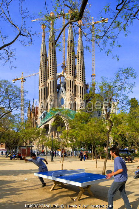 Spain, Catalonia, Barcelona, the Sagrada Familia by Antonio Gaudi listed as World Heritage by UNESCO, ping pong players