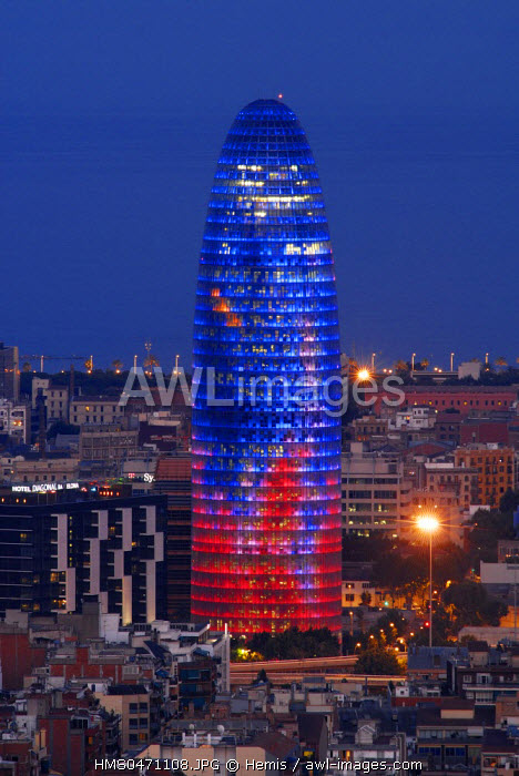 Spain, Catalonia, Barcelona, the Agbar Tower by architect Jean Nouvel seen from Guinard� park by night