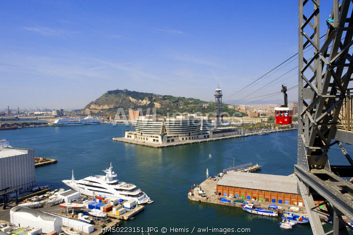Spain, Catalonia, Barcelona, overview of the new commercial port at the bottom of Montjuic and the World Trade Center Barcelona (WTCB) by architect Henry N. Cobb from the cable car
