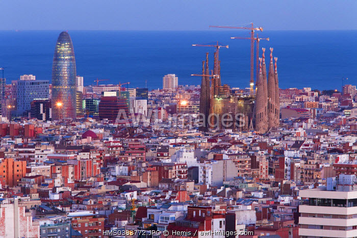 Spain, Catalonia, Barcelona, Panoramic view and skyline of the city with Sagrada Familia listed as World Heritage by the UNESCO and Agbar Tower and the Mediterranean Sea, la tour Agbar et la mer M�dit�rran�e