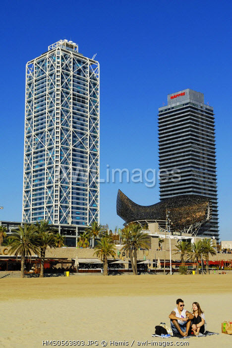 Spain, Catalonia, Barcelona, Barcelonata Beach, in the background the Peix or the Ballena (Whale) by Frank O. Gehry, the Hotel Arts and the Mapfre Insurances towers