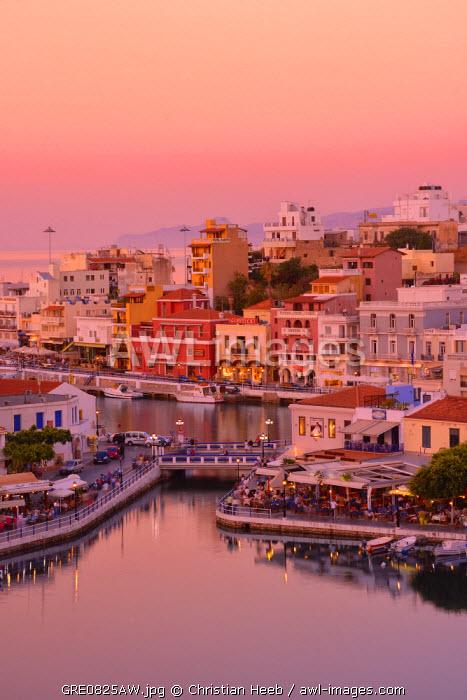 Waterfront at sunset in Agios Nikolaos, Crete, Greece, Europe