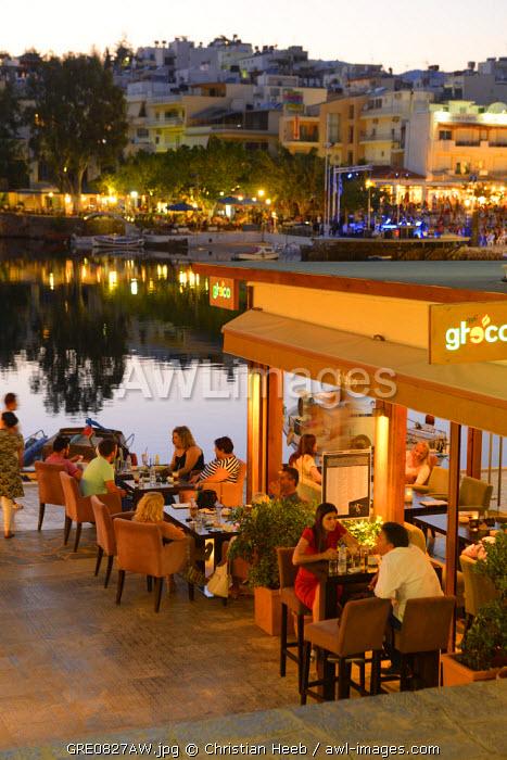 People dining at a restaurant in Agios Nikolaos, Crete, Greece, Europe