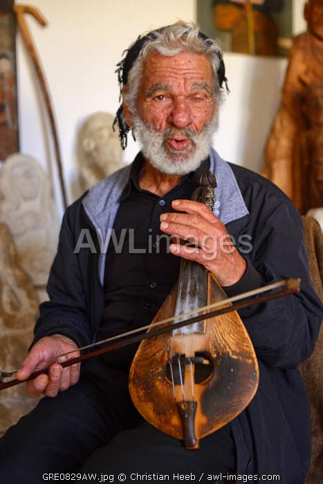 Elderly musician in Anogia, Crete, Greece, Europe