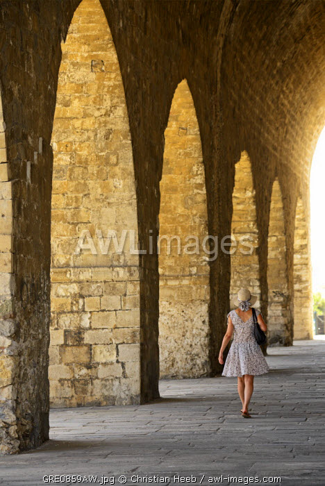 Woman walking along the Venetian shipyard, Heraklion, Crete, Greece, Europe MR 0009