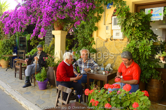 Local men at a cafe in Kroustas, Crete, Greece, Europe