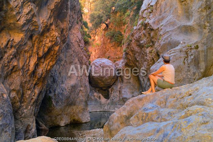 Woman hiker in Havga Gorge, Lassithi Plateau, Crete, Greece, Europe MR