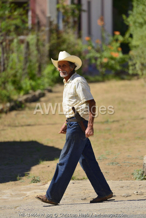 Man walking in the street of Todos Santos, Baja California, Mexico