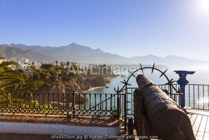Spain, Andalusia, Malaga province, Nerja. Costa del Sol seen from the Balcon de Europa viewpoint, with Sierra de Almijara mountain range