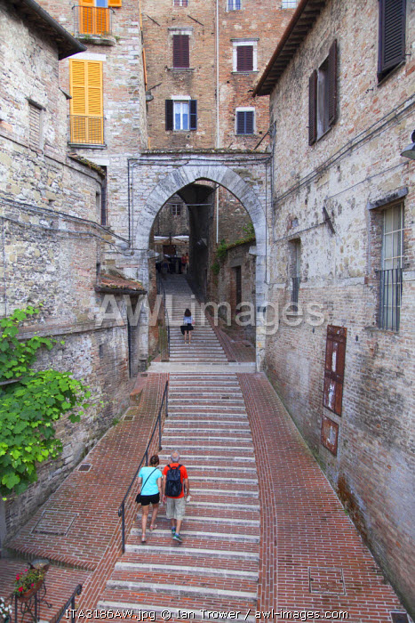 People walking along Via dei Priori, Perugia, Umbria, Italy