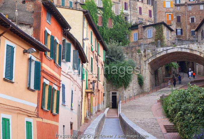 People walking along Via dei Priori, Perugia, Umbria, Italy