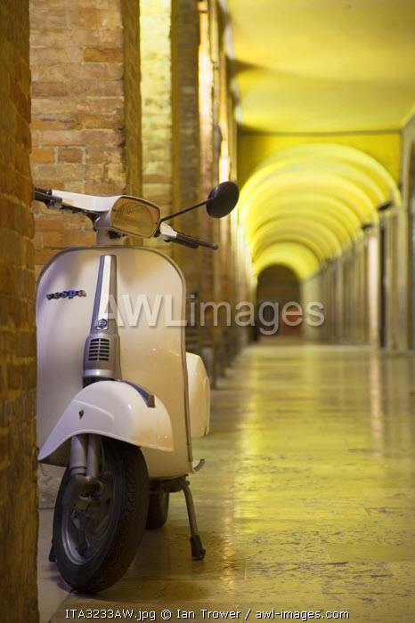 Vespa parked in covered walkway, Urbino (UNESCO World Heritage Site), Le Marche, Italy