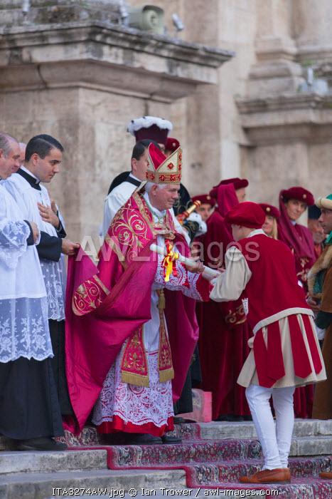 Archbishop of Ascoli Piceno at procession of medieval festival of La Quintana outside Duomo (Cathedral), Ascoli Piceno, Le Marche, Italy