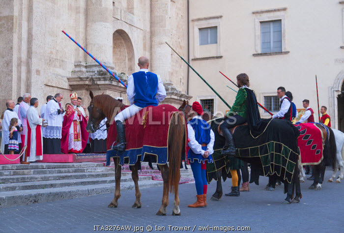 Jousters being presented to Archbishop of Ascoli Piceno at procession of medieval festival of La Quintana outside Duomo (Cathedral), Ascoli Piceno, Le Marche, Italy