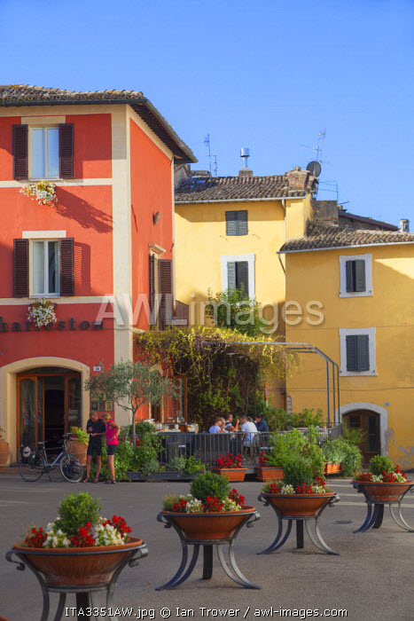 Tourists outside Hotel Charleston,in Piazza Collicola, Spoleto, Umbria, Italy