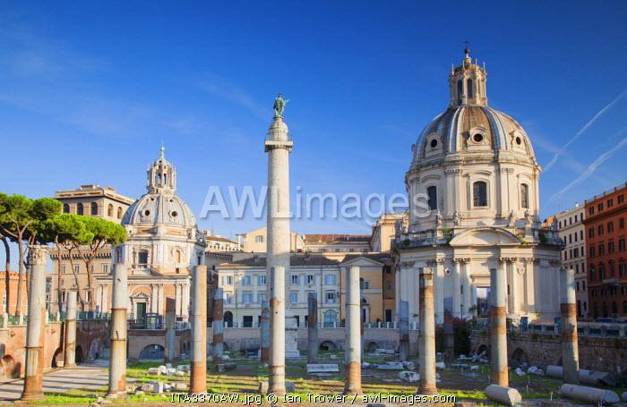 Trajan's Column (UNESCO World Heritage Site) in Trajan's Forum and church of Santa Maria di Loreto, Rome, Lazio, Italy