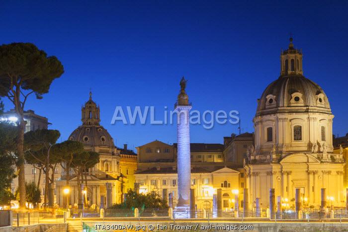 Trajan's Column (UNESCO World Heritage Site) and church of Santa Maria di Loreto at dusk, Rome, Lazio, Italy
