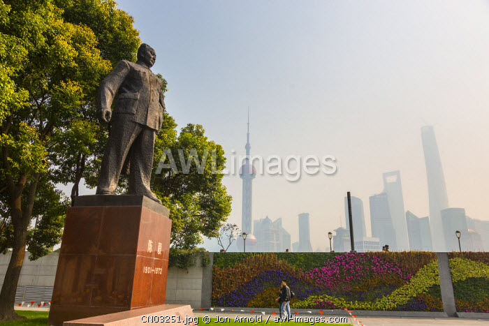 Chen Yi (1st Mayor of Shanghai) statue and Pudong skyline, The Bund, Shanghai, China