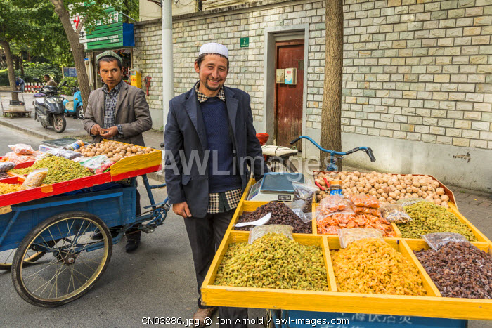 Men from Xinjiang selling dried fruit, French Concession, Shanghai, China