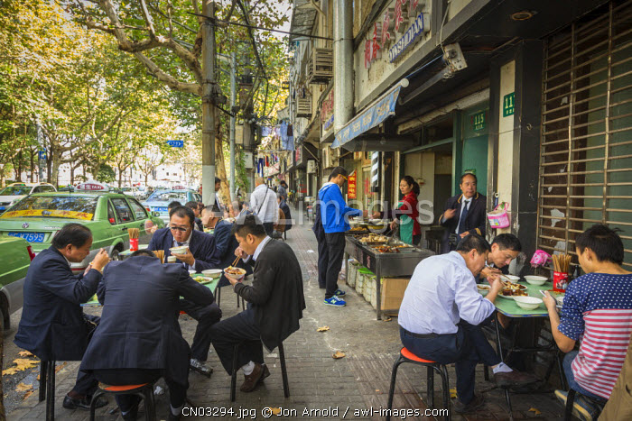 Locals eating on the pavement, French Concession, Shanghai, China