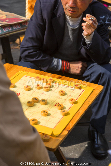 Men playing Xiangqi (chinese chess) Dongtai Road Antiques Market, Shanghai, China