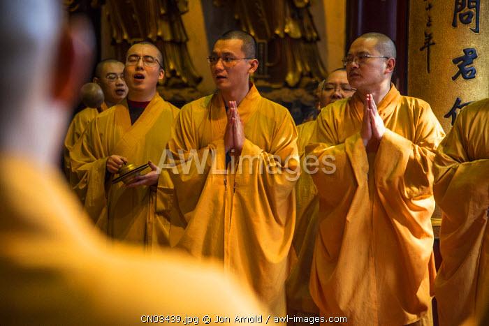 Monks inside the Jade Buddha Temple, Shanghai, China