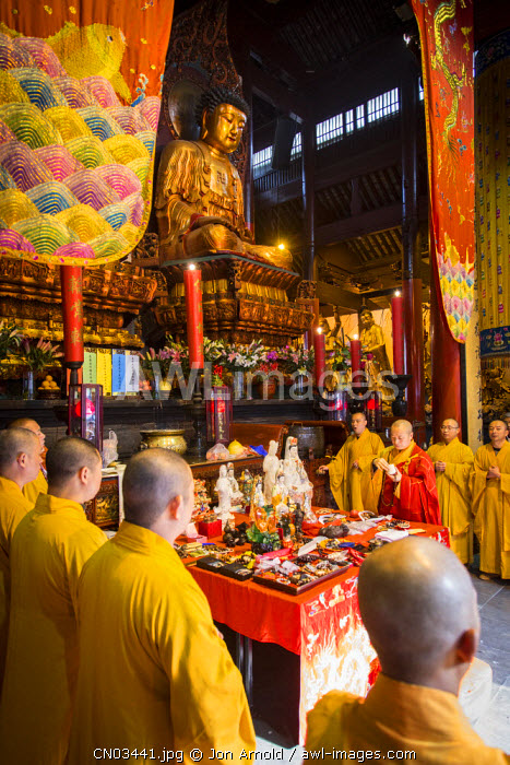 Monks inside the Jade Buddha Temple, Shanghai, China