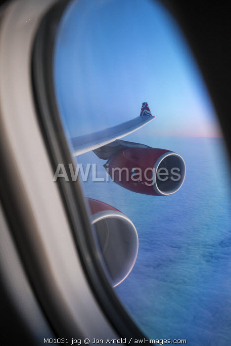 Airbus A340, view out of the window with engine and wing