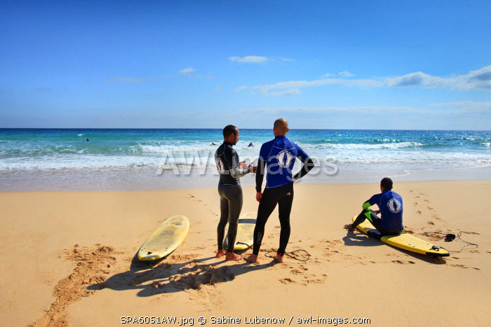 Surfer on the beach, Playa La Cazuela, El Jable, Corralejo, Fuerteventura, Canary Islands, Spain
