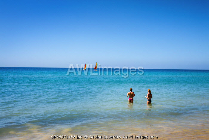 Two women in the sea, Morro Jable, Fuerteventura, Canary Islands, Spain