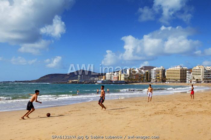 Boys playing football on beach, Playa de las Canteras, Las Palmas, Gran Canaria, Canary Islands, Spain