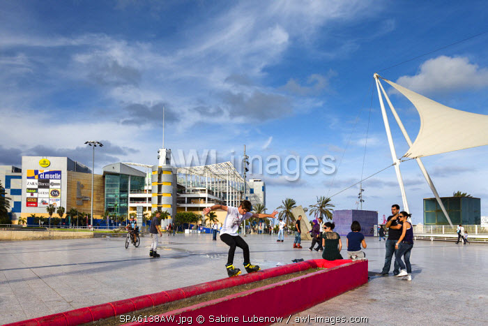 Skate boarder in front of shopping centre El Muelle, Las Palmas, Gran Canaria, Canary Islands, Spain