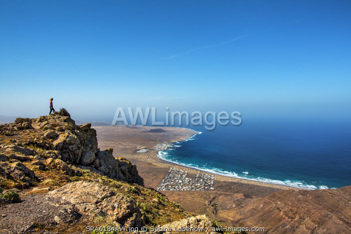 View from mountains Risco de Famara towards La Caleta de Famara, Lanzarote, Canary Islands, Spain