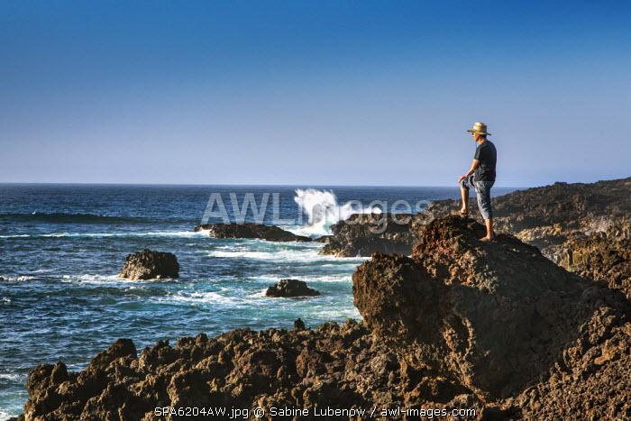 Man on the cliffs, El Golfo, Lanzarote, Canary Islands, Spain