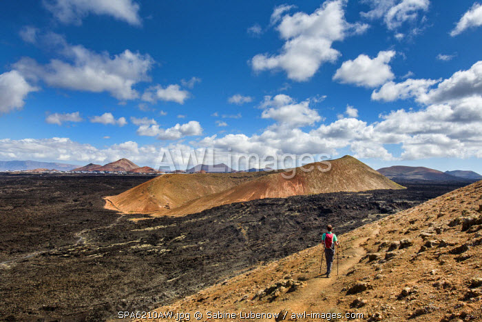 Hiker, Caldera Blanca view towards Montana Caldereta, Lanzarote, Canary Islands, Spain