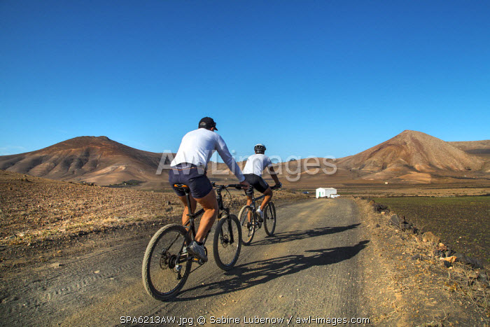 Cyclists, Los Ajaches mountains, Lanzarote, Canary Islands, Spain