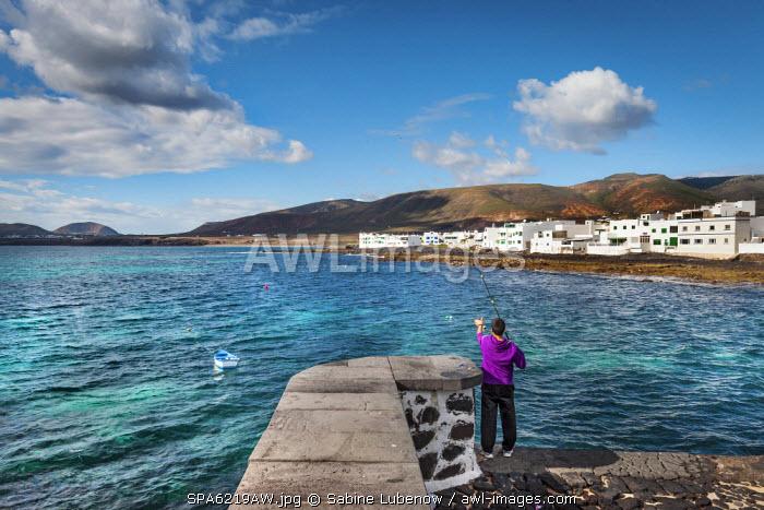 Boy with fishing rod, Arrieta, Lanzarote, Canary Islands, Spain